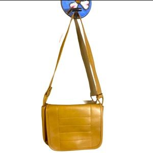 Light brown tan leather crossbody bag with flap